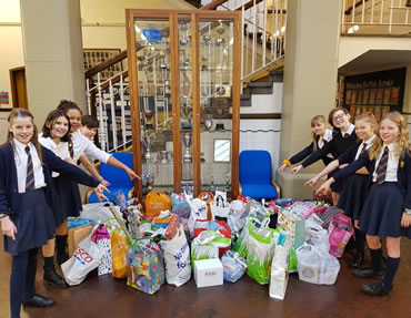 The wonderful children at Busby Primary and their Toy Drive collection!