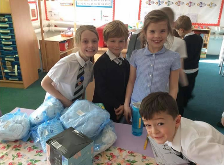 The wonderful children from Busby Primary School putting together mini Starter packs and learning about families.