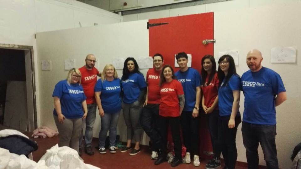 Tesco Bank volunteers decorating the Birth, Baby & Beyond warehouse